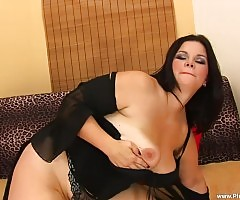 Rochelle strips out of her sexy, black lingerie, and slides her fat dildo into her twat!