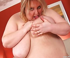 Truda strips naked and fingers her twat before fucking her dildo!