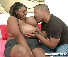 Attractive ebony fattie Minxxx readily fleshes her massive boobs.