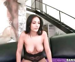 Naughty brunette hooker gets her awesome boobs oiled.