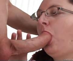 Older chubby brunette skillfully slurps dude`s craving cock.