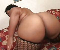 Plump black slutie with big round butt is fond of getting fucked.