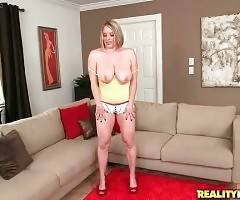 Huge titted slutie is skillfully shaking her massive natural jugs.