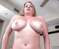 Large boobed cutie is passionately jumping on stiff dong.
